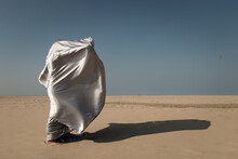 Person Wrapped In Silver Drape...