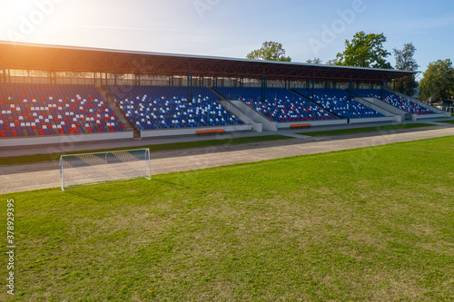 Obraz empty football stadium in the afternoon. - fototapety do salonu