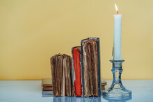 Old Books Near Burning Candle