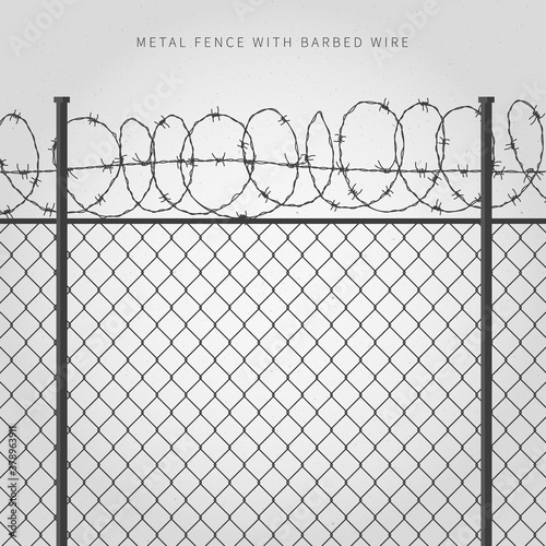 Metal fence with barbed wire Canvas Print