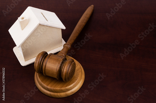 Fototapeta Real estate business and auction concept, judge gavel and house  with room for t