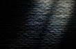 Abstract image of Sunlight shading shadow on empty space black brick wall grunge texture background.