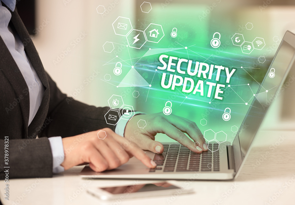Fototapeta SECURITY UPDATE inscription on laptop, internet security and data protection concept, blockchain and cybersecurity
