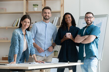 Smiling Diverse Employees Standing In Modern Boardroom, Group Portrait, Confident Successful Businesspeople Team Colleagues Looking At Camera, Posing For Corporate Photo, Human Resources Concept