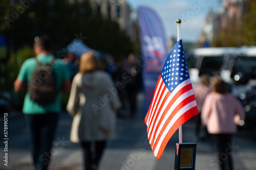 Fotografía American flag waving on the car on the 4th, thanksgiving day  of July or during