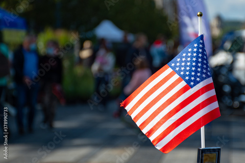 Cuadros en Lienzo American flag waving on the car on the 4th of July, thanksgiving day  or during