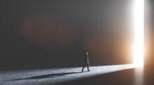 Businessman Walking Towards An Open Gate Of Light.