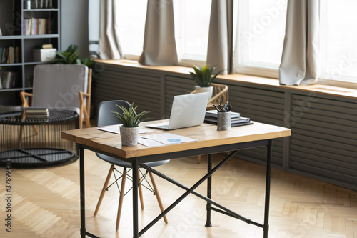 Cuadros en Lienzo Modern empty wooden table with laptop and green plant on