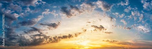 Fototapeta Panorama of dramatic sky with clouds at yellow-orange sunset. obraz