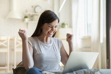 Positive Female Student In Casual Wear Overjoyed About Admission To University After Receiving Good News By Email. Happy Young Graduate With Laptop Celebrating Getting Job After Reading Notification