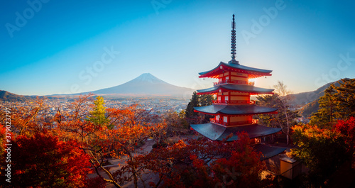 Panorama of Kawaguchiko on a Sunny autumn day. Kawaguchiko mountain area. Golden autumn in Japan. Chureito pagoda in Fujiyoshida. City at the foot of mount Fuji. Pagoda and autumn trees in Japan.
