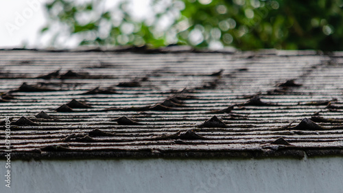 Photo Close-up of curled roofing shingles