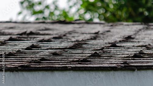 Fototapeta Close-up of curled roofing shingles obraz