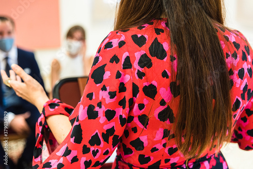 An officiant of civil wedding ceremonies dressed in a dress of hearts Wallpaper Mural