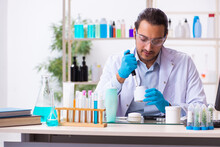 Young Male Chemist Working In ...