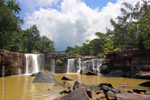 waterfall in forest with beautiful sky background