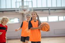 Kids In Bright Sportswear Having Basketball Game