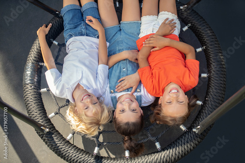 Fototapeta Kids relaxing after play and looking happy obraz