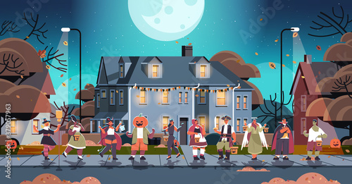 Fototapeta mix race people in costumes walking in town trick or treat happy halloween celebration coronavirus quarantine concept horizontal full length vector illustration obraz