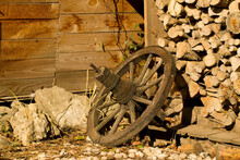 Wooden Wagon Wheel In Front Of...