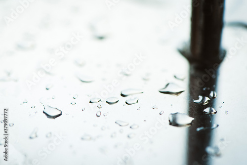 Abstract background from a drop of water on a glossy metal surface Fotobehang