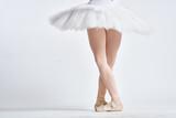 ballerina white tutu dance exercise performance light background