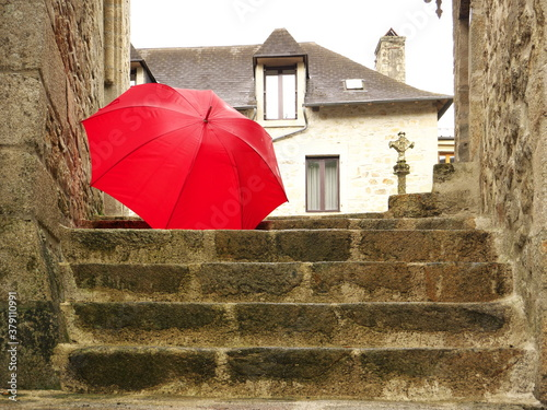 Fototapety, obrazy: Photo of a red umbrella fallen down the stone stairs