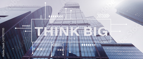 Think big text over tall office buildings Fotobehang