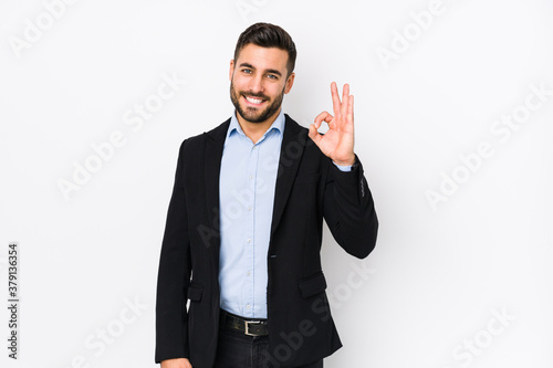 Fototapeta Young caucasian business man against a white background isolated cheerful and confident showing ok gesture. obraz