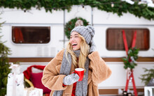 Winter Camping. Happy Laughing Female Enjoying Cup Of Tea Near Campervan Outdoors