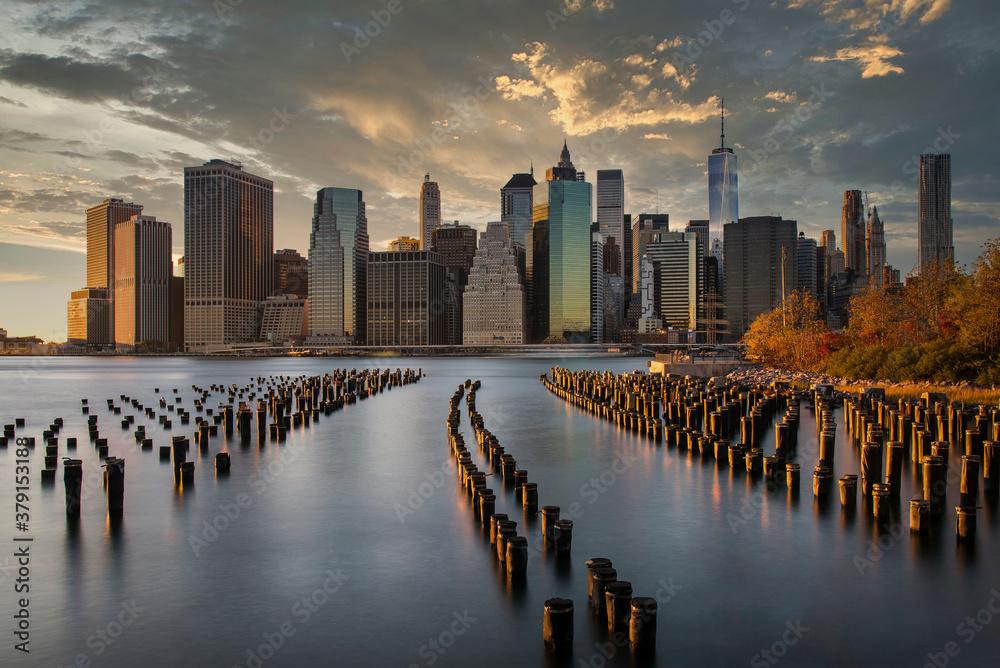 Fototapeta Lower Manhattan skyline at sunset from Brooklyn Bridge Park, Brooklyn, New York, USA