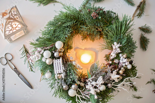 Beautifully decorated advent wreath with white decoration on a table