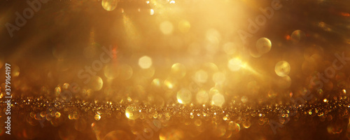 background of abstract gold and black glitter lights. defocused Canvas