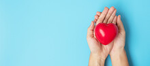 Woman Holding Red Heart Shape ...