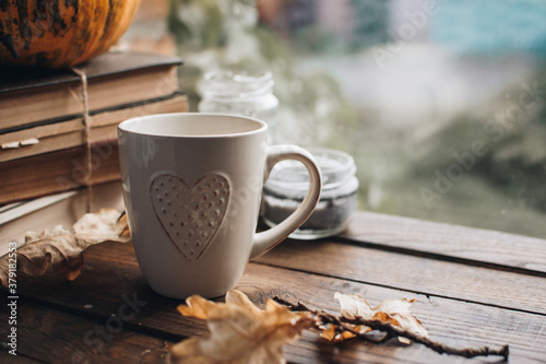 Fall styled composition. Autumn breakfast still life. Scandinavian hygge concept. Morning concept. Cozy autumn scene with pumpkins and apples. Flat lay. Home decor. Halloween and Thanksgiving concept.