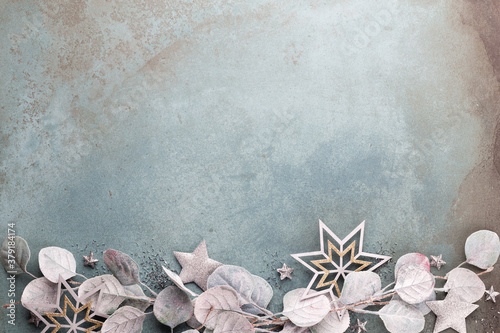 New Year celebration and Christmas background eucalyptus and Christmas star decorations top view.