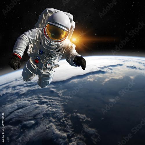 Fototapeta Astronaut at spacewalk