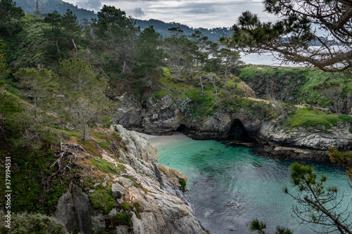 China Cove, as viewed from the hiking trails on cliffs above, at Point Lobos State Natural Reserve, a popular tourist destination in Carmel by the Sea, along the central pacific coast of California.