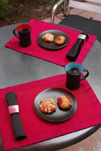 High Angle View Of A Patio Table Set For Coffee And Pastries At Home