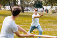 Selective Focus Of Father Throwing Ball Playing Baseball With Son In Park