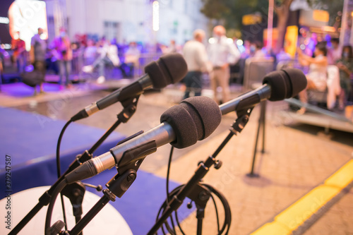 microphones ready for speakers at an event Canvas