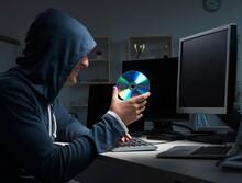Hacker Hacking Computer At Night