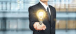 Hand of holding light bulb. idea innovation inspiration concept