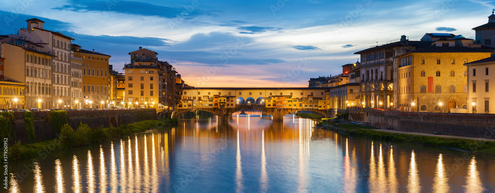 Ponte Vecchio - the bridge-market in the center of Florence, Tuscany, Italy at dusk