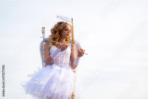 Fototapeta Angel child girl with curly blonde hair