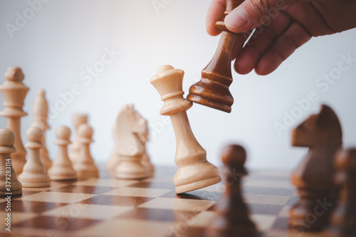 Papel de parede male hand moving chess piece on chess board game concept for ideas and competition and strategy, business success concept, business competition planing teamwork strategic concept