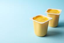 Plastic Cups Of Yellow Yogurt ...