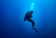 Scuba Diver Woman Standing Sti...