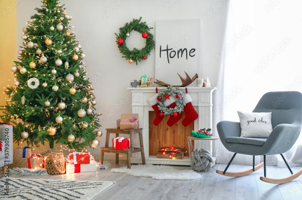 Fototapeta Interior of beautiful living room decorated for Christmas