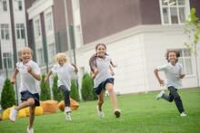 Group Of Children Having A Run...